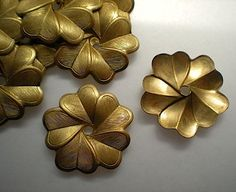 12 brass mirror rosettes, No. 5