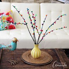 Pom pom branches take less than ten minutes to make and look so pretty in a vase! Great addition to your decor or perfect for a party table.