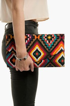 Sigh..I should have bought this when I first saw it :-(    Your Place or Mayan Clutch $44 at www.tobi.com