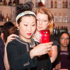 LG USA Mobile's Coverage of NYFW. Michelle Pajak-Reynolds assists model Nam Holtz in trying on the Undina Collection Luna necklace and taking a selfie as part of LG USA Mobile's coverage of Nolcha's Fashion Lounge & Media Event during New York Fashion Week.  Photo credit Julie Stanley