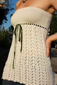 Free knitting pattern for lace top - strapless or with optional straps Lelah is a strapless (with optional strap directions in pattern) top with a fishtail lace design at the bottom, eyelet ribbon accent at the empire waist. Knit in the round this is an easy lace top for beginners!   Tank, Tops, and Tees Knitting Patterns at http://intheloopknitting.com/tops-tanks-tees-free-knitting-patterns/