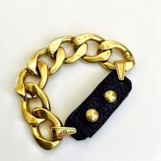 """Jenny Bird Gold Riri Bracelet. The Riri bracelet features oversized chain links with a soft genuine leather clasp. Details: 14K gold-plated brass. Length: 7"""" Width: 3/4"""" Push post closure. Gold Riri collar also available in my closet. Jenny Bird Jewelry Bracelets"""