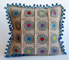Rosie Posie Grannie Square pillow, from Dada's place  - links to square pattern and pom pom edge!