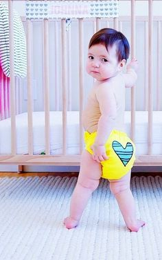 """Featuring the Fashion Collection Blue Petit Coeur on Yellow- Charlie Banana One-Size Diaper: Impressions from Earth Day this week - """"#johnnajuliet is celebrating #earthday in her #lcharliebanana #fluff We're taking major steps this year to reduce, and reuse. Highlight of the day was when daycare agreed to try using her cloth diapers!"""" #makeclothmainstream   Thank you AnneKarp!"""
