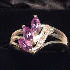 "Vint 925 Amethyst  Diamond(?) 2.92g Sterling S Vint 925 Amethyst  Diamond(?) 2.92g Sterling Silver. This pretty ring is a size 8 ¼, marked 925, has 3 amethyst sets in the top that is 3/8 x ½"", weighs 2.92 grams. The side has 2 white crystals or diamonds(?). Condition: missing 1 Crystal or diamond(?). Note this pics are blown up in size. hardly noticeable during wear. I only noticed it in enlarged pics. Pre loved. Some wear on silver see pics, again not noticeable during wear. We are not…"