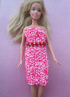 Simple tube dress knitted in Moss Stitch and decorated with pretty braid around the waist line.