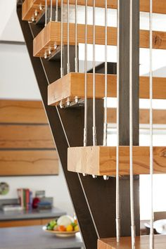 detail: wood treads / steel strings / cable rail