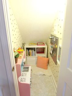 The playroom/nook. Playroom under stairs. Book nook.