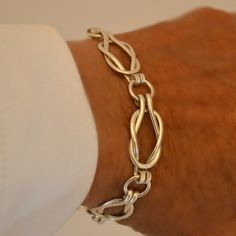 The bracelet style is called the Sailors Knot or Love Knot. This listing is for the heavier weight version, made with 12 gauge sterling silver