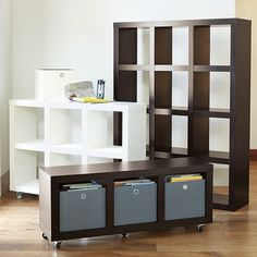 Different size etegeres make great room dividers and storage units