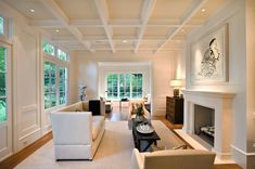Pacific Peninsula Group: Beautiful, monochromatic living room in shades of creamy white. Highbacked sofa, narrow ...