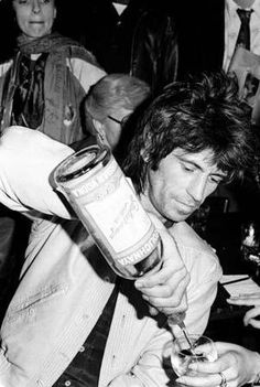 A vintage picture of Keith Richards (Rolling Stones) with a bottle of Stoli vodka!