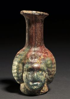 Object: Double-Sided Flask 1 of 3 ca. 1st to 2nd-century A.D. Culture: Roman Measurement: h. 6.50 cm. Provenance: Ex-English Private Collection, England, 1975. Published: J. Eisenberg, Art of the Ancient World, 2014, No. 143. Cf. Kunstmuseum Luzern ed., 3000 Jahre Glaskunst, 1981, S. 82, No. 279. GMF05 Jerome M. Eisenberg, Inc. © 1999 - 2017 Bottles And Jars, Flask, Galleries, Roman, Objects, England, Culture, Collection, Art