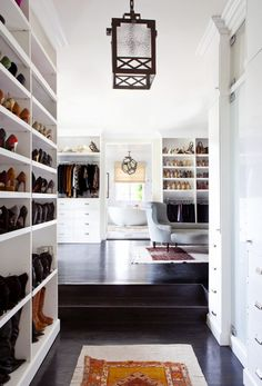 White closet with runner leading into sitting area.