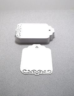 50 Large Fancy Gift Tags- Wish Tree Tags- Price Tags- Favor Tags White Cardstock Smooth. $7.50, via Etsy.
