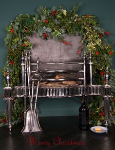 English 18th Century Polished Steel Fire Grate with fire tools and Christmas Wreath.