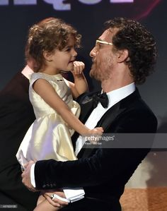 Honoree Matthew McConaughey (R) accepts the American Cinematheque Award with Vida Alves McConaughey (L) onstage at the 28th American Cinematheque Award honoring Matthew McConaughey at The Beverly Hilton Hotel on October 21, 2014 in Beverly Hills, California.  (Photo by Kevin Winter/Getty Images)