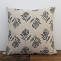 This cushion cover is block printed with handcarved linoleum blocks.