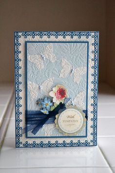 hand crafed sympathy card by Aly Dosdall: Anna Griffin Cuttlebug embossing folder used to embed white butterflies on baby blue paper ... gorgeous!