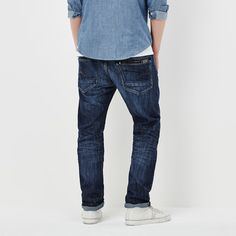 The Attacc jean is defined by its rugged back pockets; one with a half-concealed zip, and both with flat-rivets and stitched leather on bonded rubber.