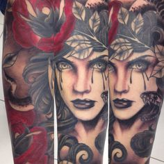 Black and grey arm wrap red roses