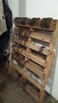 Storage and organizer for horse shoes. Another easy, no building necessary, use for pallets. Label each board with a size of shoe.