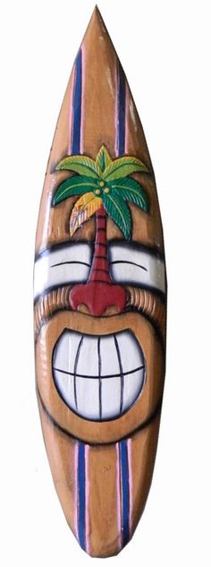 Forever Bamboo's Smiley Palm Surfboard Mask is hand painted and carved from eco-friendly Albesia wood. Albesia wood is naturally light in weight and can easily be installed on any solid surface area. We offer free shipping and handling on our 40 inch surfboard masks and will carefully inspect each product prior to shipment. Decorate your home, commercial business, hotel, or restaurant with our eye-catching surfboard masks. These masks are great decoration pieces for Hawaiian themed parties.