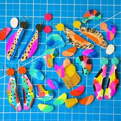 A mix of hand painted pieces ready to be turned into colorful earrings!
