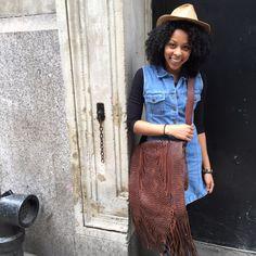 Buffalo Exchange Chelsea employee rocks a denim dress for spring with an amazing braided fringe cross-body.