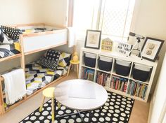 Shared boys geometrical bedroom. Combination of IKEA and Kmart styling monochrome & yellow theme. IKEA shelves, bunk, rug, bunks and storage containers. Kmart bed spreads, coffee (Lego) table, shadow box, light box & stools.