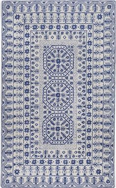 I found this on www.burkedecor.com Smithsonian Collection New Zealand Wool Area Rug in Dark Slate Blue and Ivory 5' x 8' is $770
