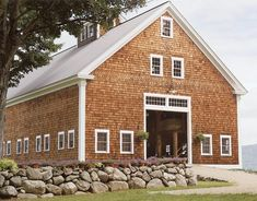 Big wooden barn with white trim