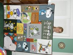 snoopy lap-size t-shirt quilt.  What a great idea for all the T-Shirts I have.  Must find someone to make this for me!!  :)