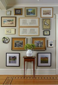 A beautiful example how to mix frames and use the entire wall when doing a gallery.  (Lynn of Decor Arts Now)  See the rest of her home tour on my blog here:  http://emilyaclark.blogspot.com/2012/01/house-tour-lynn-of-decor-arts-now.html
