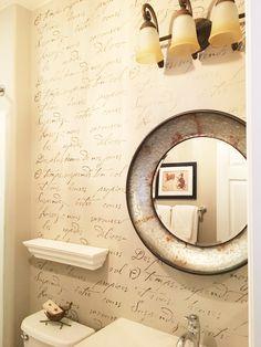 A stenciled bathroom accent wall using the French Poem typography wall pattern from Cutting Edge Stencils. http://www.cuttingedgestencils.com/french-typography-letter-wall-stencil.html