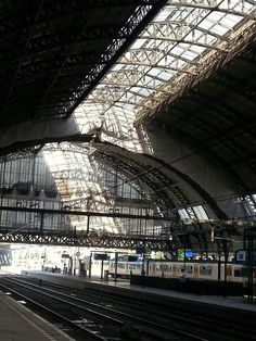 https://flic.kr/p/Ly74tS   2016.09 - Amsterdam photo in streaming light, under the old smoke cap of Central Station - geotagged free urban picture, in public domain / Commons; Dutch photography, Fons Heijnsbroek, The Netherlands   Amsterdam photo of the 'light cathedral' Central Station Amsterdam city with its remarkable architecture iron construction of the riveted station hood (to collect the smoke / steam of the steam locomotive), built circa 1900.   Urban photography of Amsterdam, The…