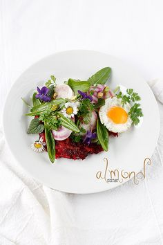 Spring salad with edible flowers on beetroot rösti by almondcorner, via Flickr