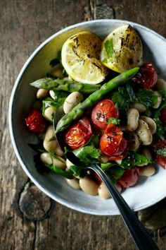 White beans, roasted cherry tomatoes and asparagus, cilantro and a nice light sauce with some lemon squirted over top! Light, simple, and delicious!