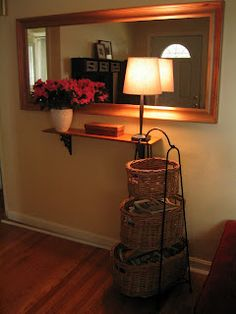 Small Place Style: Entryways I really do like this, love the trio of baskets.