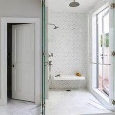 Shower with White and Gray Herringbone Tiles and Floating Shower Bench