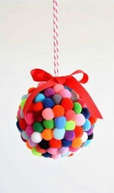 Pom poms have been the star of our countless childhood crafts, and taken an even cuter form as colorful wreaths and ornament balls.