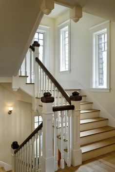 Arts & Crafts are carried throughout the staircase, landing and interior spaces of this new Shingle-style home by Smith & Vansant Architects.