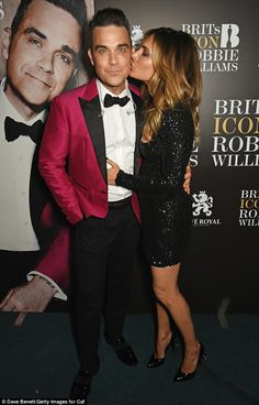 Pucker up! Robbie Williams, 42, and Ayda Field, 37, still looked to be in the first flushe...