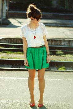 lovely spring/summer look. green skirt, lacy top with cute heart necklace, messy updo, and sunglasses.