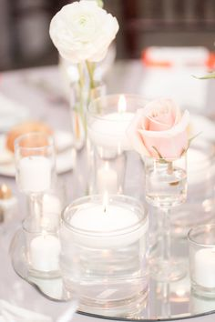 Candle and floral centerpieces   Photo by Idalia Photography