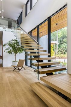 Staircase, Wood Tread, and Glass Railing Set on top of a forested ridge separating downtown Portland and the suburban sprawl of Beaverton, OR, Wildwood by Giulietti / Schouten AIA Architects is a rural retreat and primary residence hidden within th Home Stairs Design, Interior Stairs, Modern House Design, Home Interior Design, Modern Stairs Design, Staircase Glass Design, Modern Home Interior, Modern Wood House, Modern Railing
