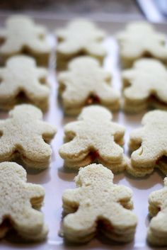 Perfect Christmas Appetizer: Gingerbread shaped sandwiches. any cookie cutter shape would be cute