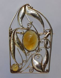 WIENER WERKSTÄTTE Important Secessionist Brooch  Gilded silver Citrine Marks: 'WW' Austrian, c.1910 Fitted Case Although there is no designer monogram this brooch has all the style of a good Josef Hoffmann design.