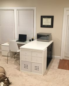 """How to hide a large dog crate: 1) 42"""" X 30"""" X 28"""" crate 2) Ikea Kallax 3) 59"""" Ikea Table Top 4) Any Ikea Cubby Inserts I turned mine into an L-desk and put a microwave on top. My home office is now dog central for my large dog."""