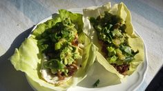 Breakfast cabbage taco with fried egg, pork and guacamole